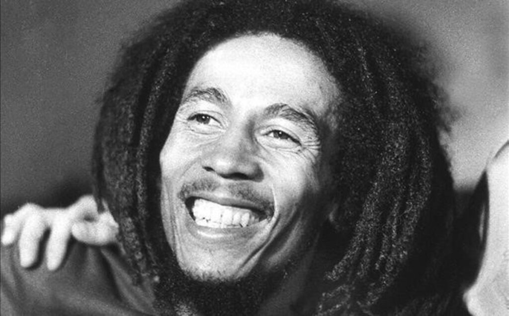 The best of Bob Marley's songs. Bob Marley smiling.