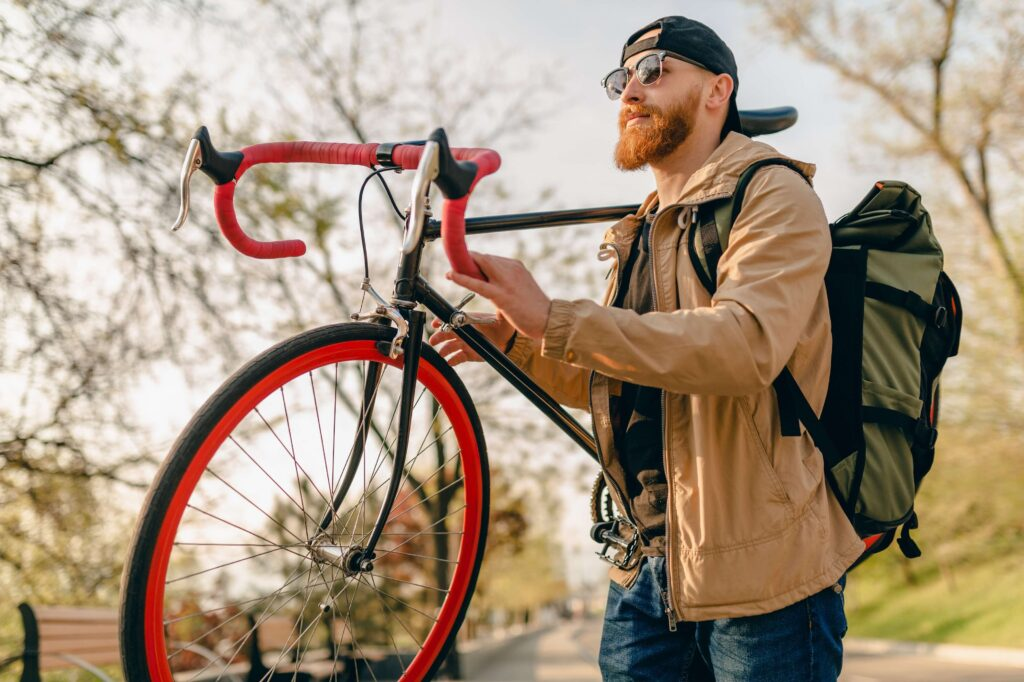 The best cities for biking in the world. Man with a bike in the city