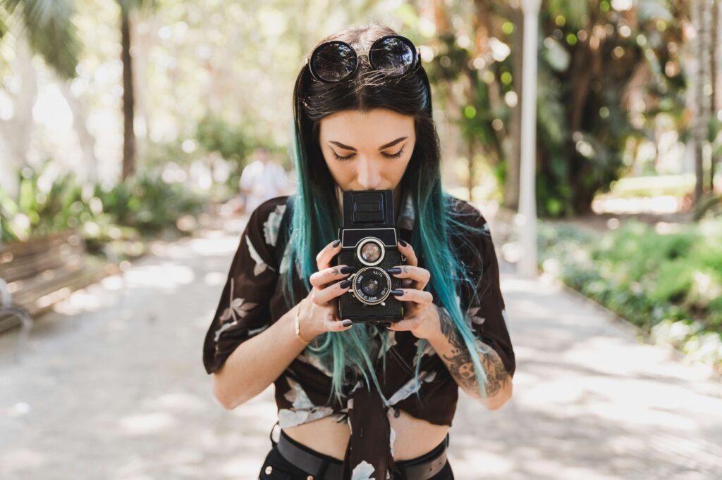 The most famous street photographers in the world. Young woman with a camera.