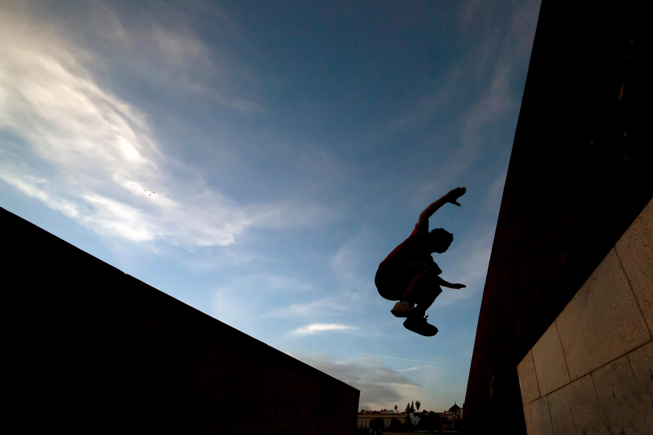 What is parkour? Young man practicing parkour.