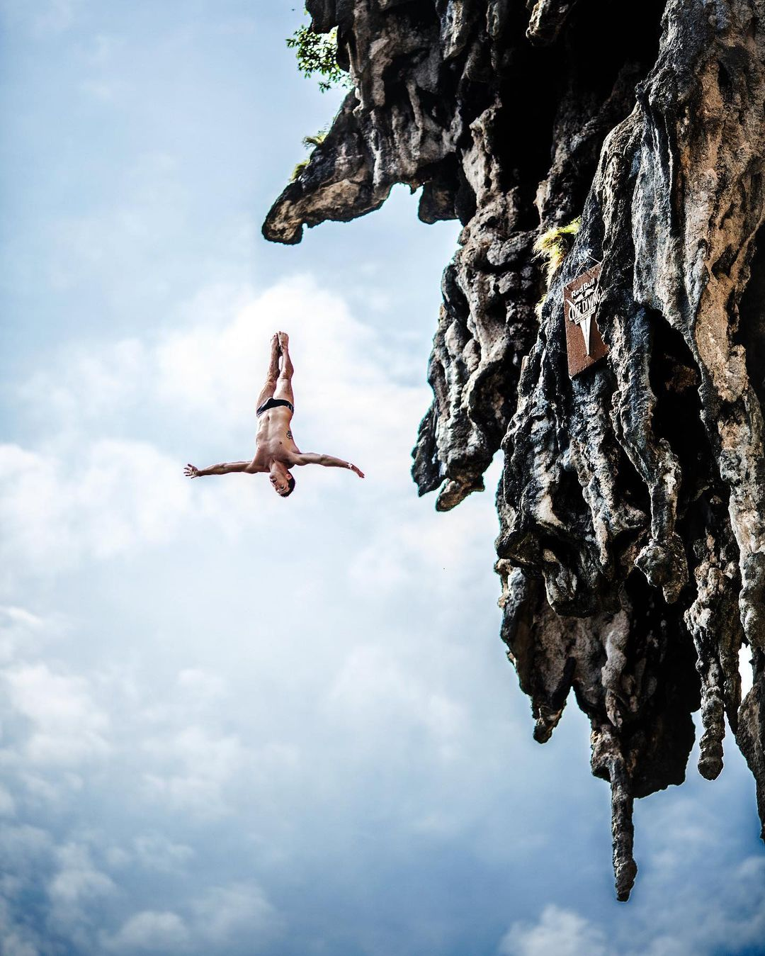 A man practicing cliff diving.