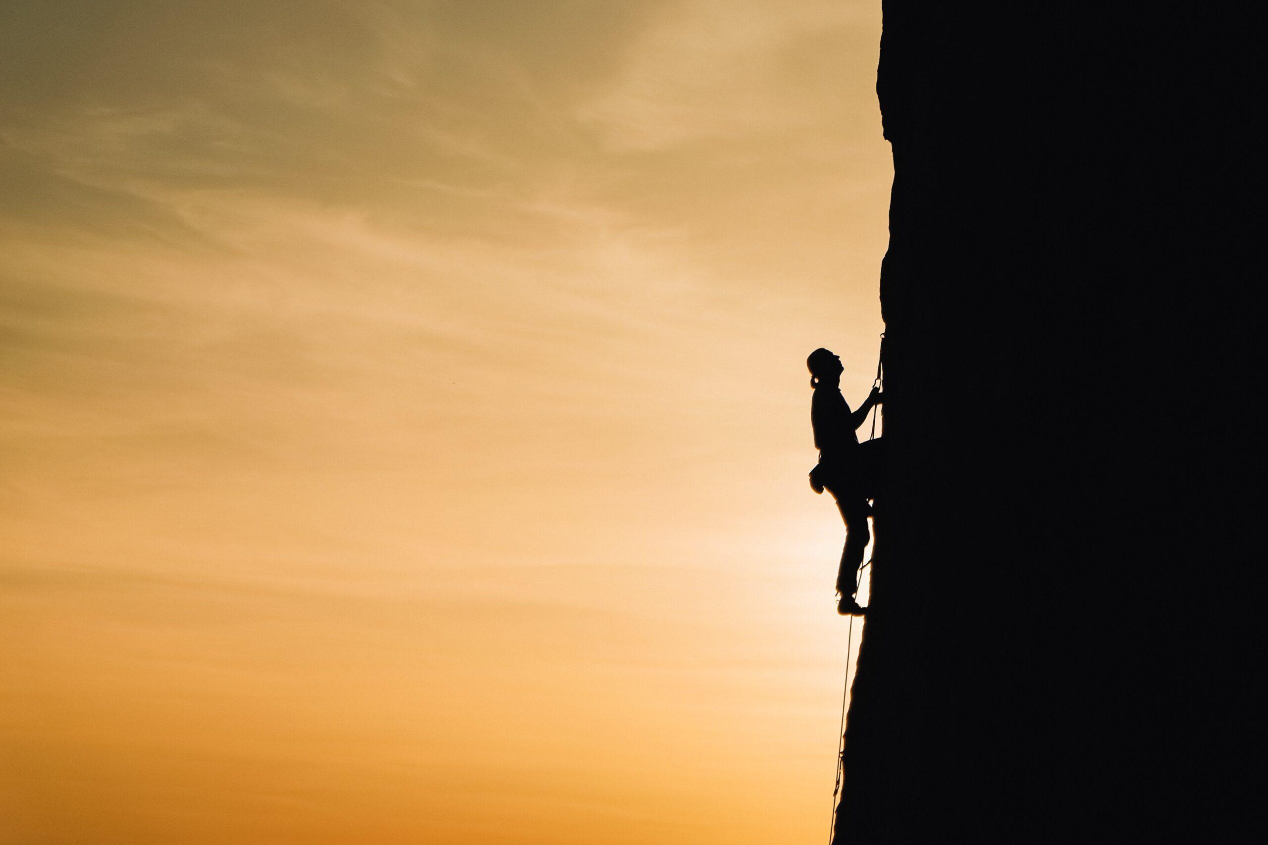 Climbing Workout: a person practising rock climbing.