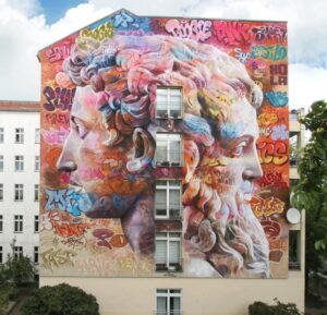 Janus, mural by the artist duo Pichiavo in Berlin, the result of their participation in the Berlin Mural Fest.