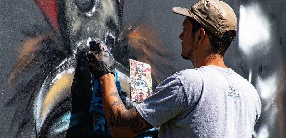 Famous street artists. Street artist painting.