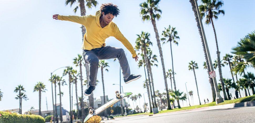 Skateboards mythical brands. Man practising skateboarding